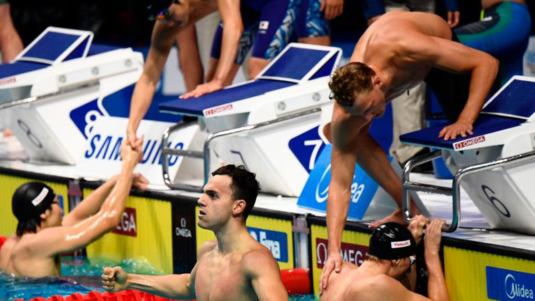 Great Britain's James Guy and teammates react after winning the men's 4x200m freestyle relay final