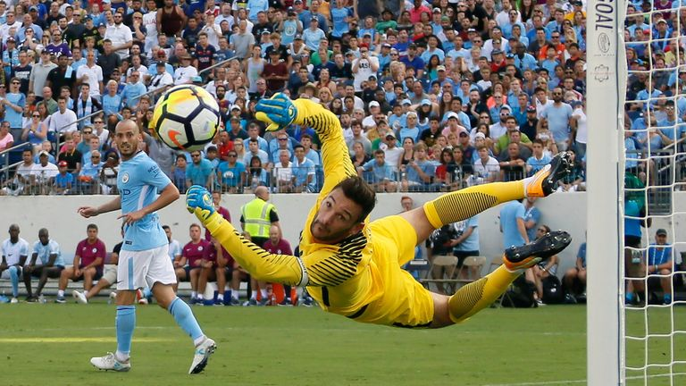 Hugo Lloris makes a flying stop to keep out a shot