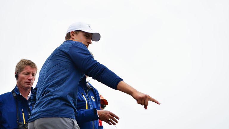Spieth discussed with rules officials for nearly 20 minutes about where he would take his penalty drop