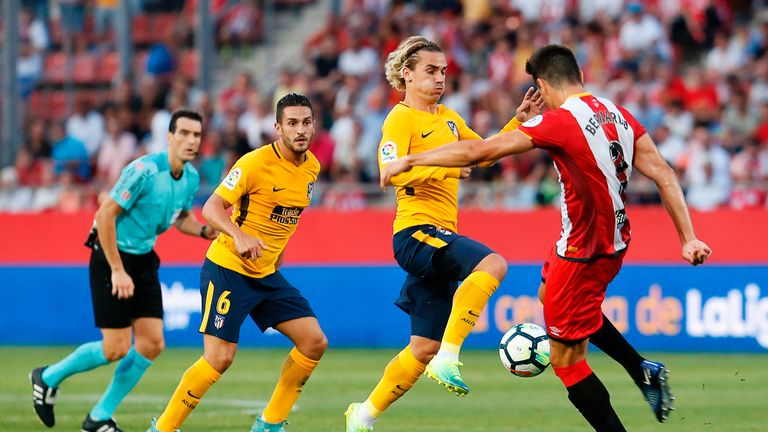 Antoine Griezmann was sent off as Atletico Madrid failed to win in their visit to newly-promoted Girona