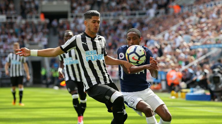 Ayoze Perez and Kyle Walker-Peters challenge for the ball
