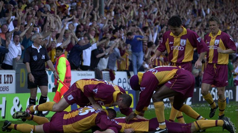 Bradford's players celebrate their winner against Liverpool