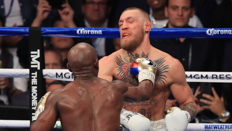 Mayweather throws a punch at McGregor