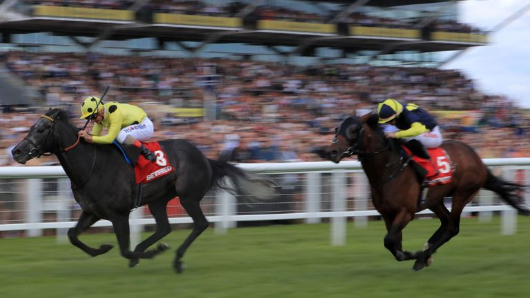 Defoe (left) on the way to winning the Betfred Geoffrey Freer Stakes