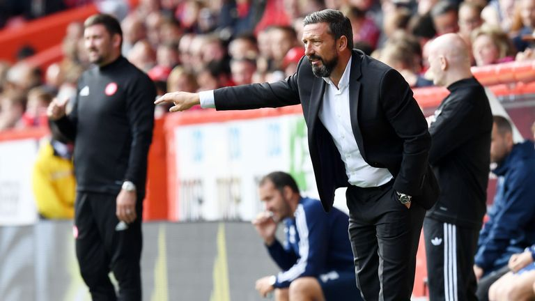 Aberdeen manager Derek McInnes watches on
