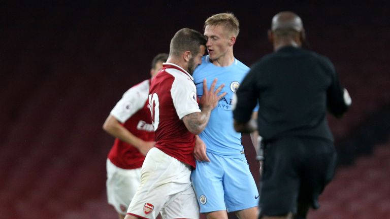 Jack Wilshere shoves Matthew Smith of Manchester City leading to his sending off during the Premier League 2 match at the Emirates Stadium