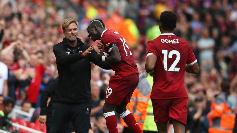 Mane celebrates scoring his side's first goal with Jurgen Klopp