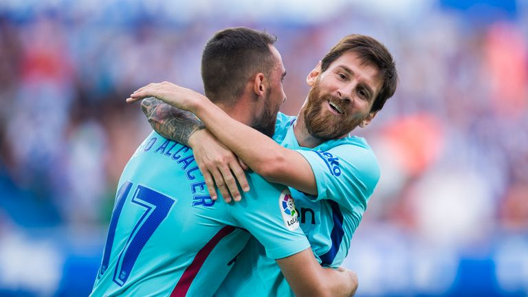 Lionel Messi celebrates with Paco Alcacer