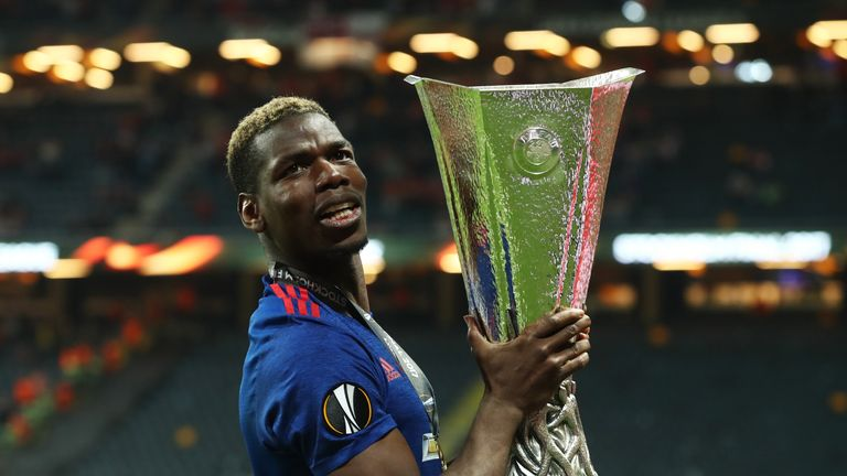 Paul Pogba celebrates with the Europa League trophy