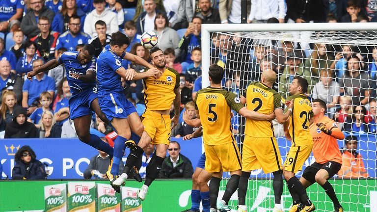Harry Maguire beat team-mate Wes Morgan to the ball to head in Leicester's second on his home debut
