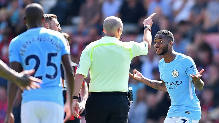 Raheem Sterling is sent off by referee Mike Dean after receiving a second yellow card