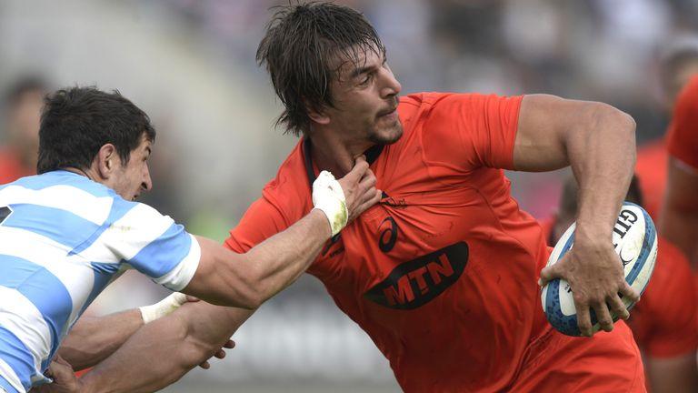 South Africa's lock Eben Etzebeth (R) runs through a tackle by Argentina's scrum-half Tomas Cubelli