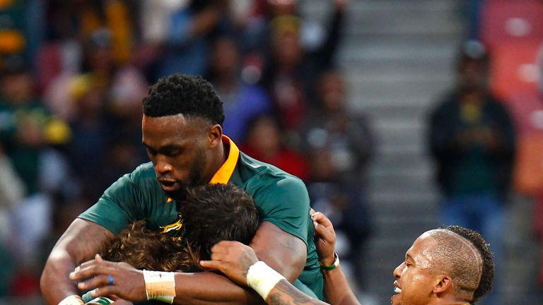 The Springboks celebrate Courtnall Skosan's try at the end of the first half