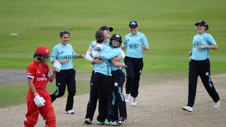 Surrey Stars players celebrate after beating Lancashire Thunder