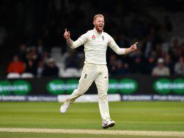 Ben Stokes of England celebrates taking the wicket of Jason Holder