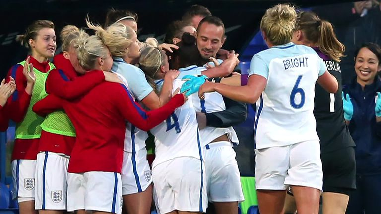Nikita Parris and the England squad celebrate with Mark Sampson during a 6-0 win over Russia in September 2017