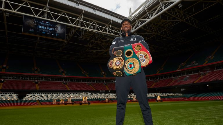 Joshua defends his world titles against Carlos Takam at the Principality Stadium