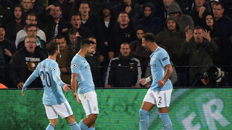 Sergio Aguero (centre) celebrates putting City 2-0 up