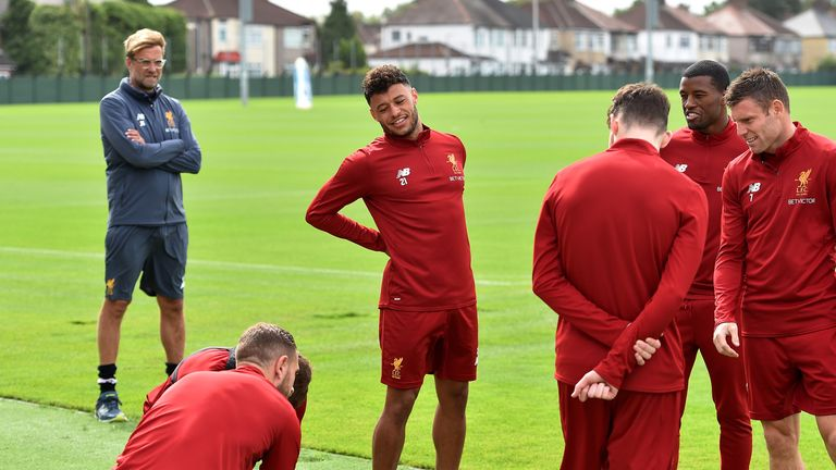 Jurgen Klopp looks on as Alex Oxlade-Chamberlain takes part in his first training session at Melwood since moving from Arsenal