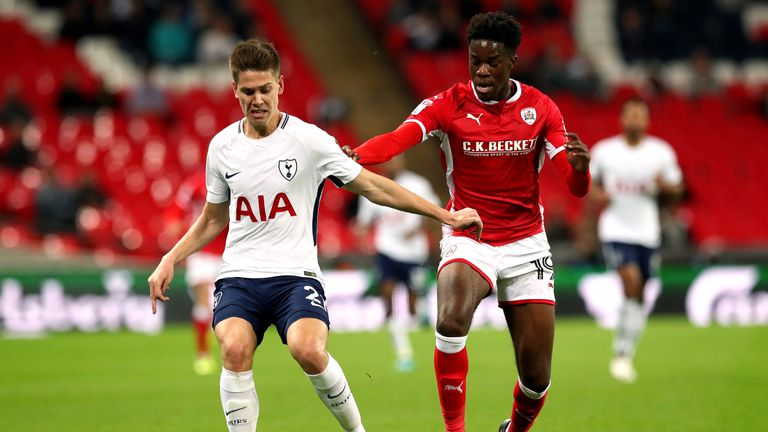 Barnsley's Ike Ugbo (right) and Tottenham Hotspur's Juan Foyth (left) battle for the ball