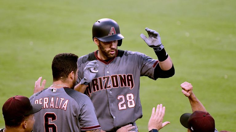 J.D. Martinez celebrates after hitting one of his four home runs