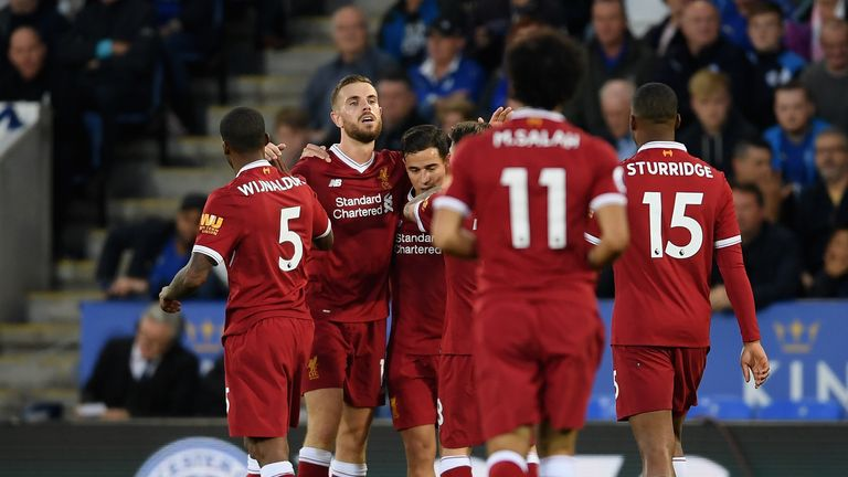 Jordan Henderson celebrates after scoring Liverpool's third goal at Leicester