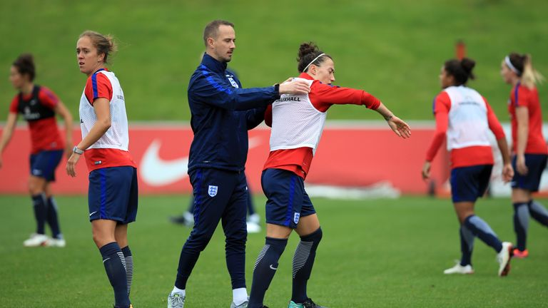 Lucy Bronze appears to shrug off Mark Sampson (left) during the training session