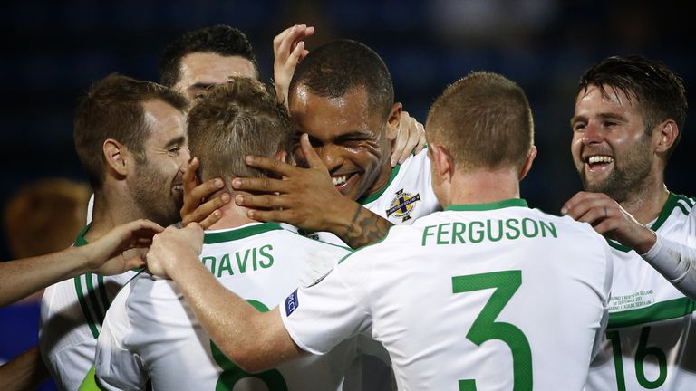 Northern Ireland beat San Marino 3-0 on Friday to close in on a World Cup play-off place