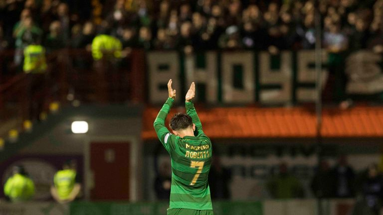 The returning Patrick Roberts applauds the travelling support as he's replaced