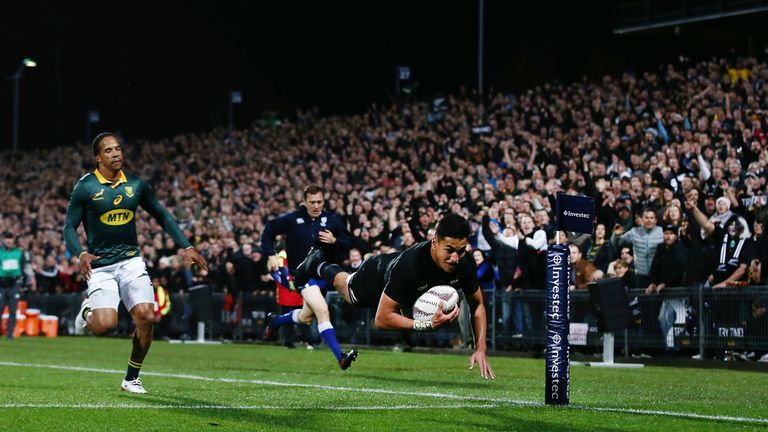 Rieko Ioane of the All Blacks scores a try against South Africa