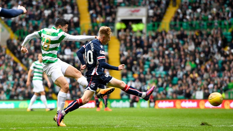 Tom Rogic (left) opened the scoring after 13 minutes