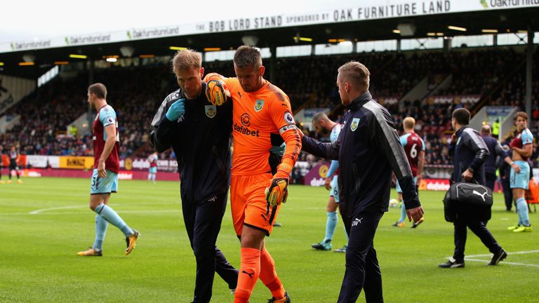 Burnley captain Tom Heaton is helped off after dislocating his shoulder