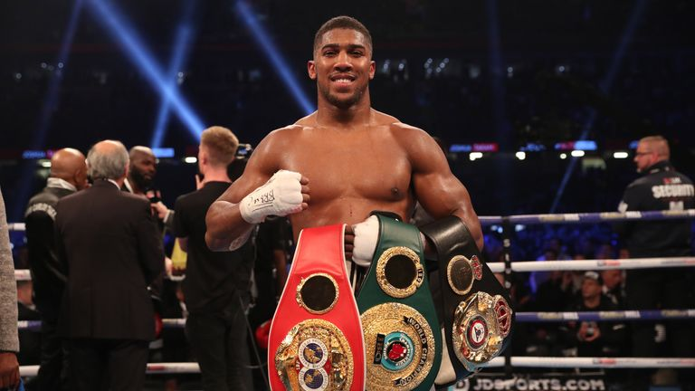 Anthony Joshua retains world titles after stopping Carlos Takam in 10th round