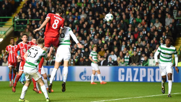 Javi Martinez rises above Nir Bitton to head in Bayern Munich's winner and secure their place in the last 16 of the Champions League