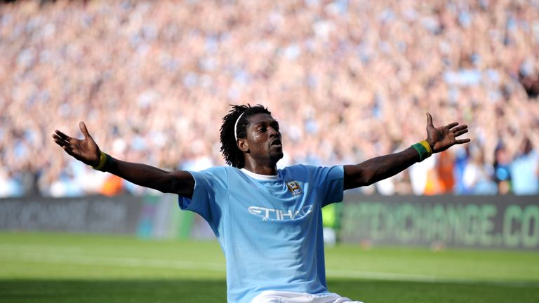 Adebayor celebrates in front of the Arsenal fans after scoring for Manchester City