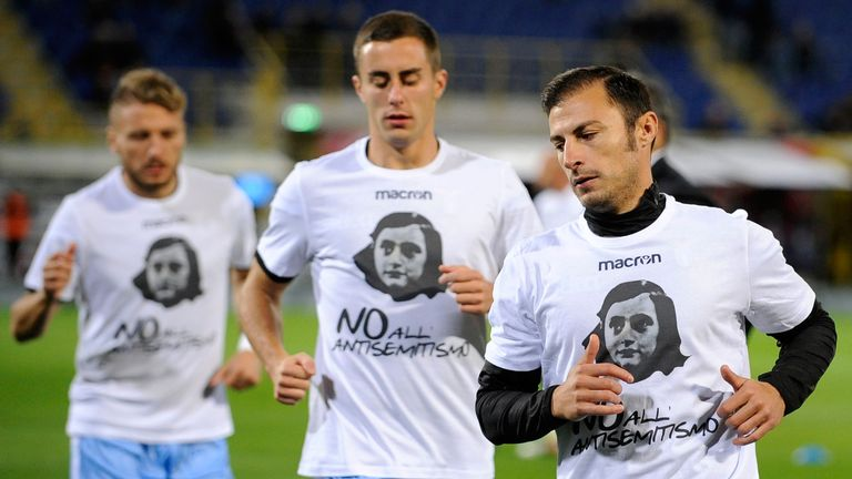 Lazio wear shirts depicting Anne Frank saying 'no to anti-Semitism', in response to anti-semitic graffiti left by their fans at a previous match
