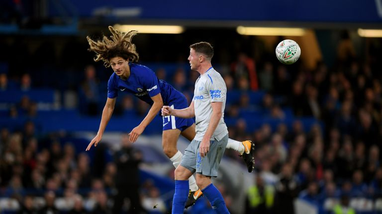 Ethan Ampadu wins the ball from James McCarthy during the Carabao Cup match