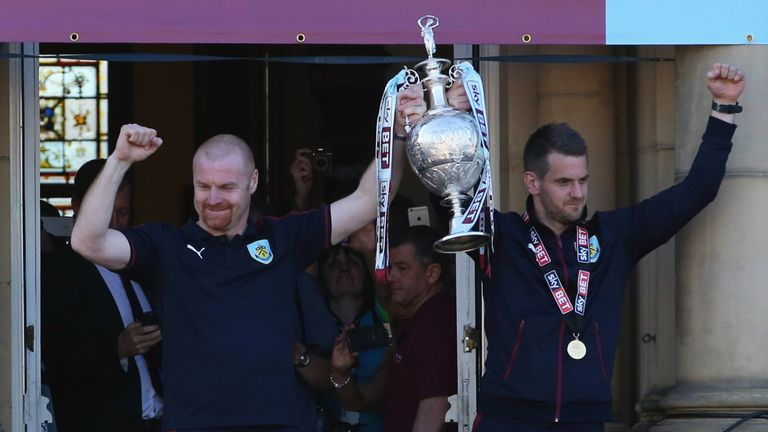 Dyche and Tom Heaton celebrate with the Championship trophy in 2016