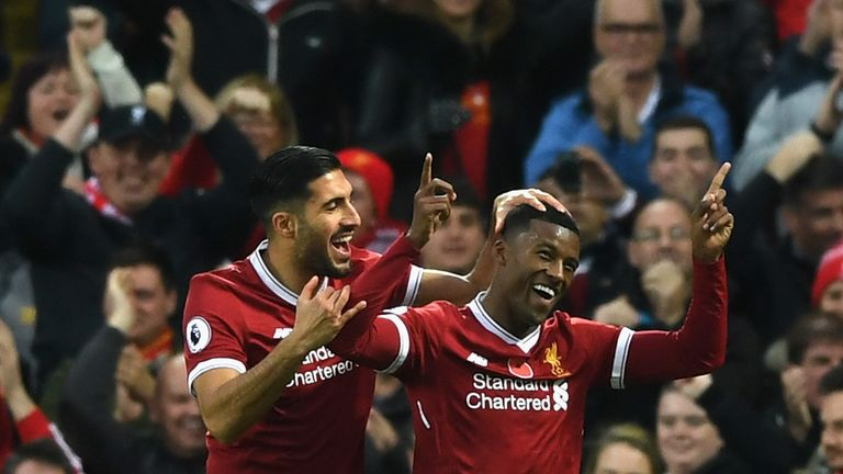 Georginio Wijnaldum of Liverpool celebrates scoring his side's third goal with Emre Can