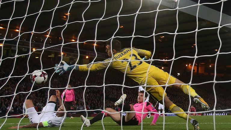 Martin Skrtel watches on as his attempted block of Anya's cross ends up going into the net