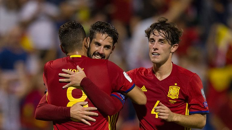 Spain booked their place at next summer's World Cup in Russia with a 3-0 win over Albania