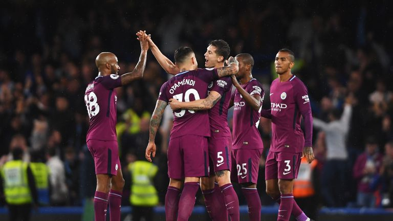Man City's players celebrate their crucial win at Stamford Bridge