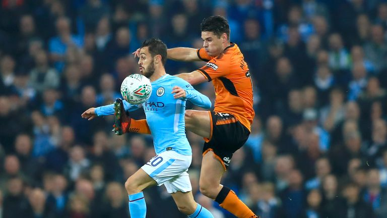 Manchester City's Bernardo Silva (left) and Wolves' Ben Marshall battle for the ball on Tuesday night