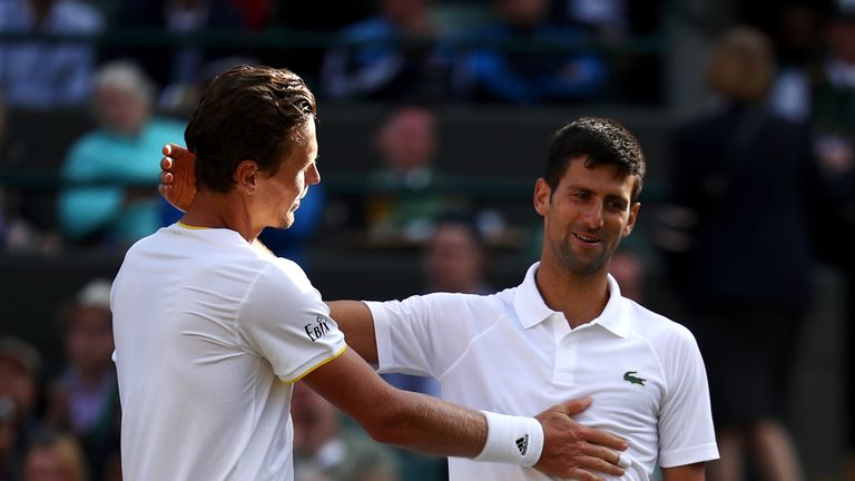Novak Djokovic (right) was forced to retire injured against Tomas Berdych at Wimbledon