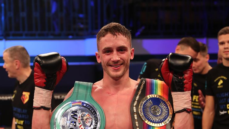 Bellotti poses with the Commonwealth Featherweight Championship
