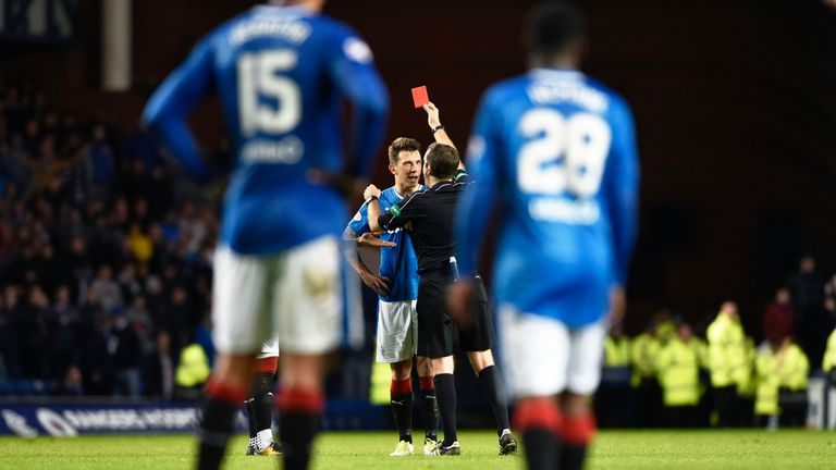 Ryan Jack (centre) is sent off during the dramatic finish at Ibrox