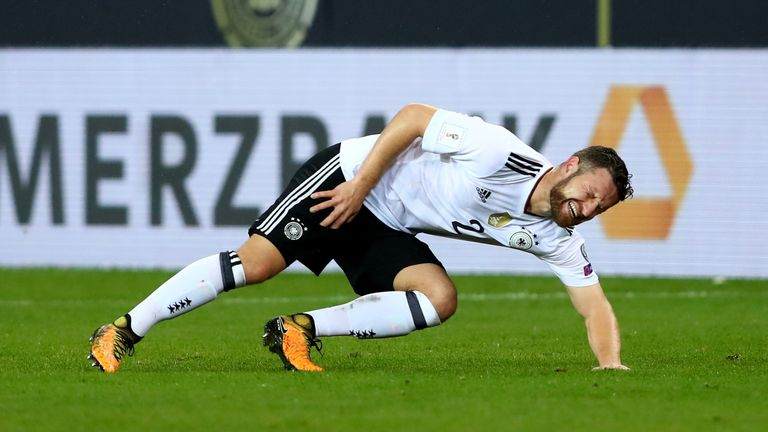 Shkodran Mustafi went down clutching his right thigh and groin area