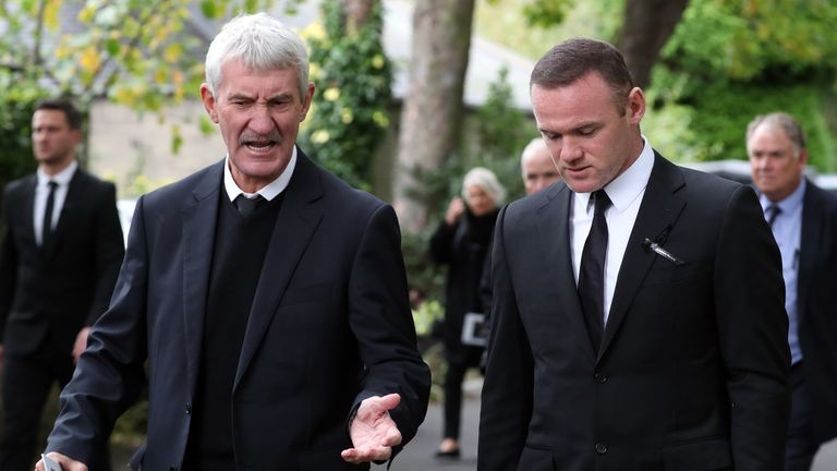 Former Newcastle player Terry McDermott speaks to Wayne Rooney after the service