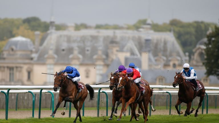 Wild Illusion (L, blue) win the Total Prix Marcel Boussac - Criterium Des Pouliches at Chantilly