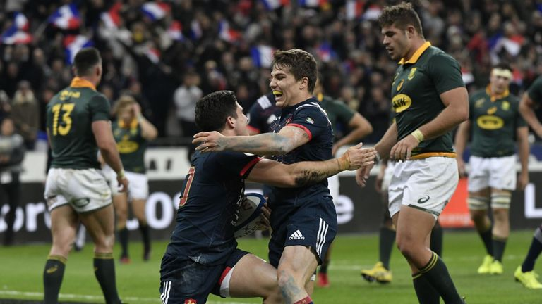 Anthony Belleau celebrates after scoring France's first try